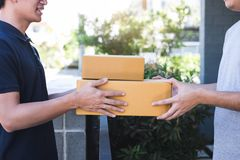 Delivery mail man giving parcel box to recipient, Young owner accepting of cardboard boxes package from post shipment, Home. Delivery mail men giving parcel box royalty free stock image