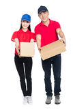 Delivery mailman carrying cardboard box Royalty Free Stock Images