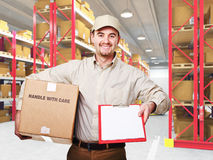 Delivery man. At work and 3d boxes background stock image