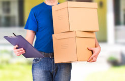Delivery man. Image of a delivery man with package Stock Image