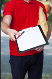 Delivery man asking for signature Royalty Free Stock Photography