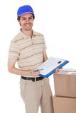 Delivery man asking to sign delivery confirmation Stock Image