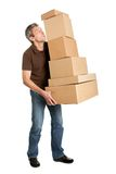 Delivery man balancing stack of boxes Royalty Free Stock Photography