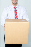 Delivery man with box. Delivery man carries the box Stock Photo