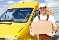 Delivery man with box Royalty Free Stock Image