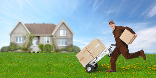 Delivery man with box running Stock Photos