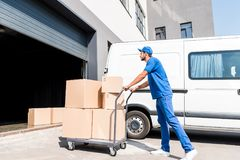 Delivery man with boxes on cart Stock Photo