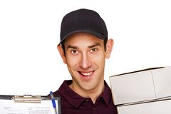 Delivery man with boxes isolated over white background. Royalty Free Stock Image
