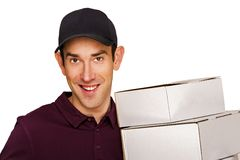 Delivery man with boxes isolated over white background. Stock Photo