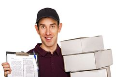Delivery man with boxes isolated over white background. Royalty Free Stock Photos