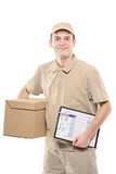A delivery man bringing a package Royalty Free Stock Photo