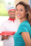 Delivery man bringing pizzas Stock Images