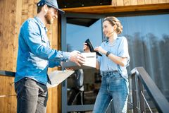 Delivery man bringing shoes to a woman royalty free stock photo