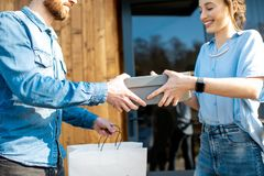 Delivery man bringing shoes to a woman royalty free stock photos