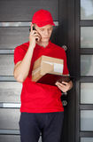 Delivery man calling his client Stock Images