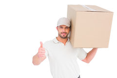 Delivery man with cardboard box gesturing thumbs up Royalty Free Stock Photos