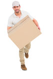 Delivery man with cardboard box running Stock Photos