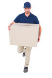 Delivery man with cardboard box running on white background Royalty Free Stock Images