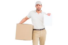 Delivery man with cardboard box showing clipboard. On white background Royalty Free Stock Photo