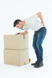 Delivery man with cardboard box suffering from back ache Royalty Free Stock Photos