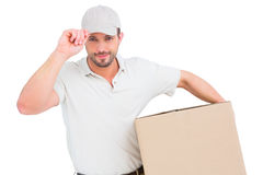 Delivery man with cardboard box wearing cap Stock Photography