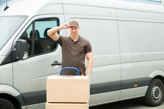 Delivery Man With Cardboard Boxes In Front Van Royalty Free Stock Images
