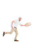 Delivery man with cardboard boxes running Stock Photo