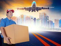 delivery man and cargo plane flying over urban skyline for delivering and logistic business stock photography