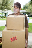 Delivery Man Carries Packages Stock Photos