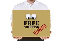 Delivery man carry a free shipping parcel Stock Images
