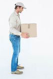 Delivery man carrying cardboard box Royalty Free Stock Images