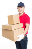 Delivery man carrying cardboard box Royalty Free Stock Image