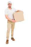 Delivery man carrying cardboard box Stock Photography