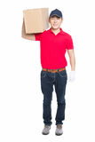 Delivery man carrying cardboard box Royalty Free Stock Photos