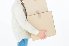 Delivery man carrying cardboard boxes Royalty Free Stock Photo