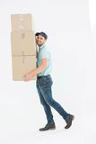 Delivery man carrying cardboard boxes Stock Images