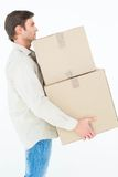 Delivery man carrying cardboard boxes Stock Image