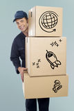 Delivery man carrying a cardboard boxes Stock Photography