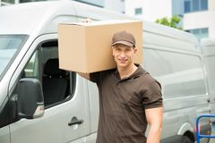 Delivery Man Carrying Cardboard Boxes Royalty Free Stock Image