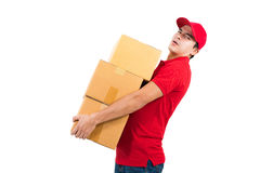 Delivery man carrying heavy boxes. On white background Stock Photography