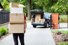 Delivery man carrying package stack Royalty Free Stock Images