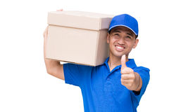 Delivery man carrying a parcel box and giving thumbs up Stock Photos