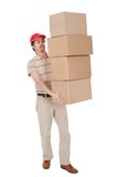 Delivery man carrying stack of boxes Stock Images