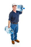 Delivery Man Carrying Water. Strong delivery man carrying two five gallon water bottles.  Full Body isolated on white Stock Image