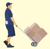 Delivery Man. Caucasian delivery man with hand truck Royalty Free Stock Photos