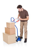 Delivery Man With Clipboard And Boxes Royalty Free Stock Images
