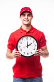 Delivery man with clock. On white Stock Photos