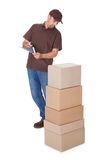 Delivery Man Counting Boxes Royalty Free Stock Photos