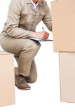 Delivery man counting cardboard boxes Royalty Free Stock Photo