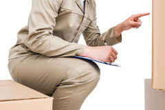 Delivery man counting cardboard boxes Royalty Free Stock Image